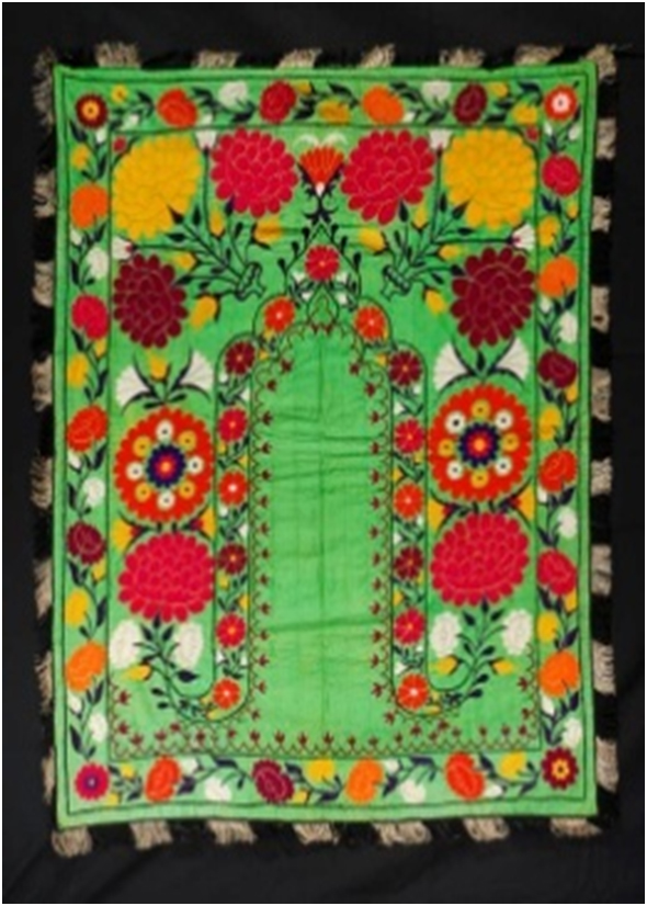 Floral patterned green suzani hanging