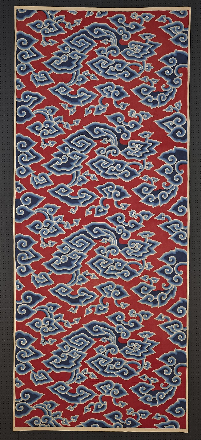 Batik lower body wrapper with design of cloud on a red ground